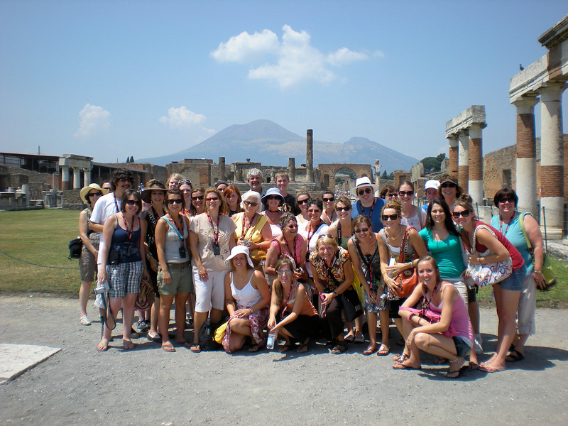 Lutheran West tour group in hot and sunny Pompeii, Italy overlooking Mt. Vesuvius during a 2008 trip to Spain, France and Italy led by Lynn Pangrace and Kathie Courtney.