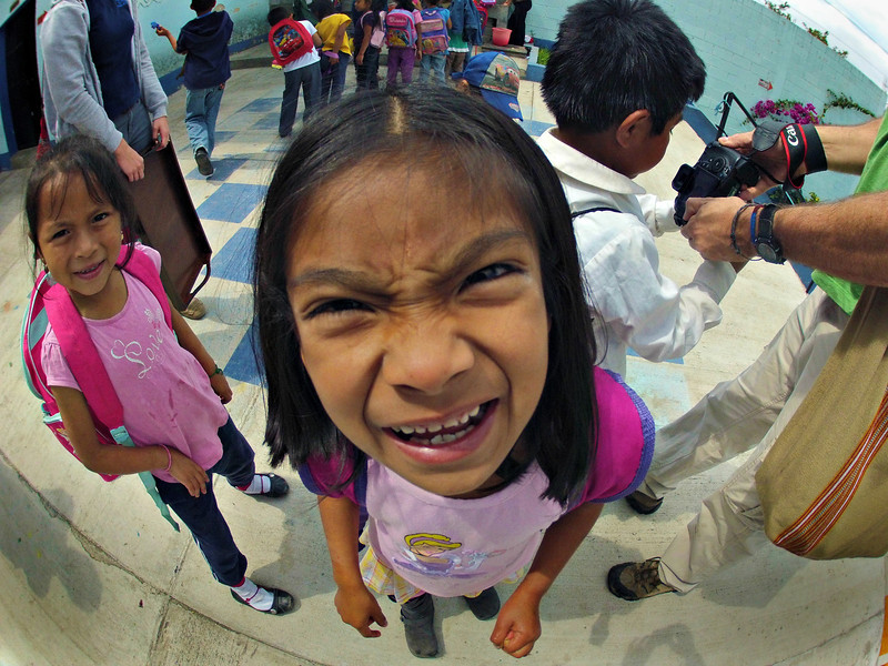 A student at Ninos de Guatemala tries to figure out what kind of camera she is looking at. This was taken with a GoPro by Faith Fuller.