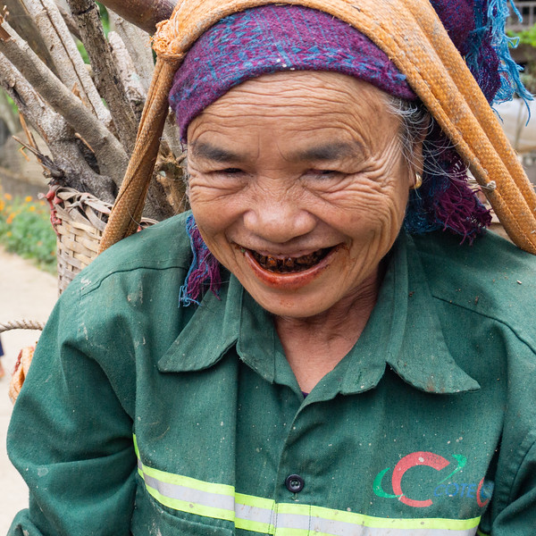An old woman we encountered on our village walk.  The TL bought her some egss.  Notice the beetle nut stains on her teeth