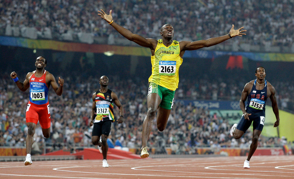 . In this Aug. 20, 2008  file photo made by Associated Press photographer Anja Niedringhaus, Jamaica\'s Usain Bolt crosses the finish line to win the gold in the men\'s 200-meter final at the Beijing 2008 Olympics in Beijing.  (AP Photo/Anja Niedringhaus, File)