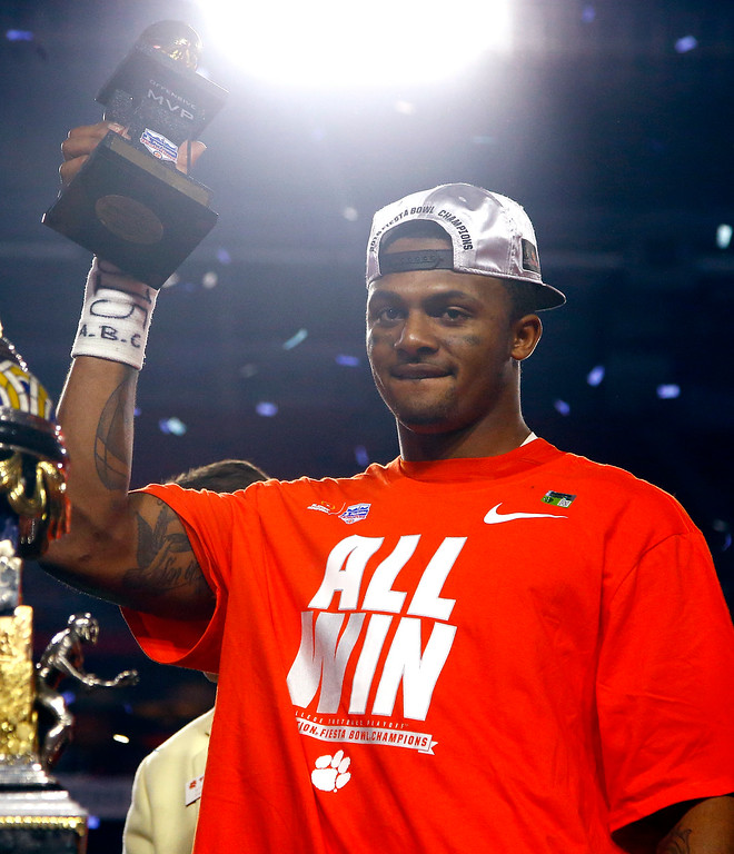 . Clemson quarterback Deshaun Watson holds the offensive player of the game trophy after the Fiesta Bowl NCAA college football playoff semifinal, against Ohio State, Saturday, Dec. 31, 2016, in Glendale, Ariz. Clemson won 31-0 to advance to the BCS championship game on Jan. 9 against Alabama. (AP Photo/Ross D. Franklin)
