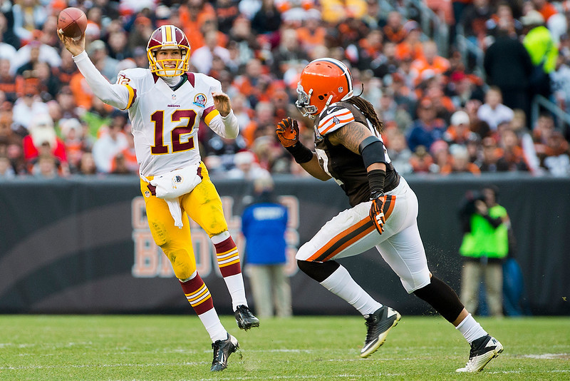 . Quarterback Kirk Cousins #12 of the Washington Redskins passes under pressure from defensive end Jabaal Sheard #97 of the Cleveland Browns during the second half at Cleveland Browns Stadium on December 16, 2012 in Cleveland, Ohio. The Redskins defeated the Browns 38-21. (Photo by Jason Miller/Getty Images)