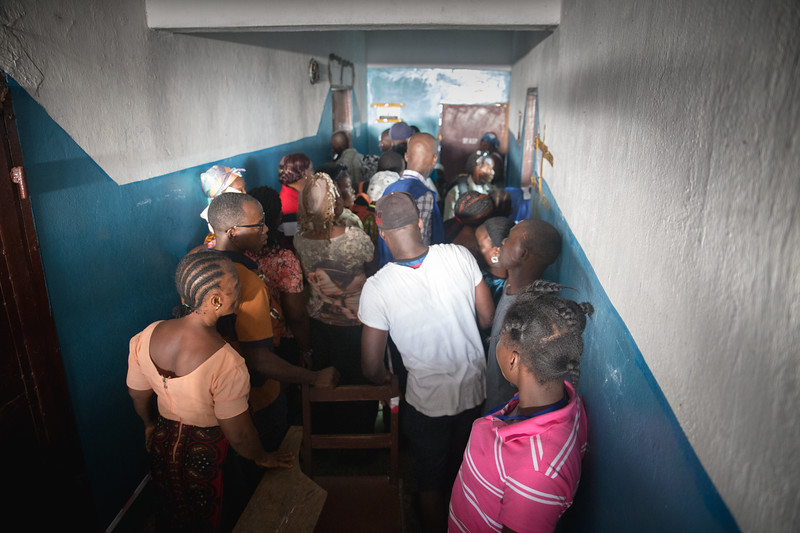 Monrovia, Liberia October 10, 2017 -  Voters make their way through a hallway at a polling station on election day.
