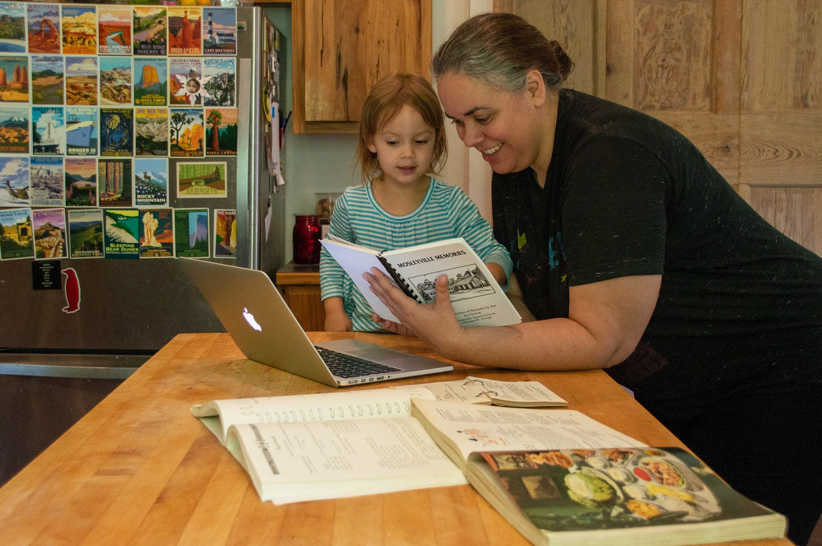 Opperman works on the cookbook at home with her daughter, Isabel.