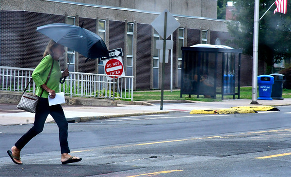 8/13/2019 Mike Orazzi | Staff A woman darts across a rainy North Main Street on Tuesday in Bristol.