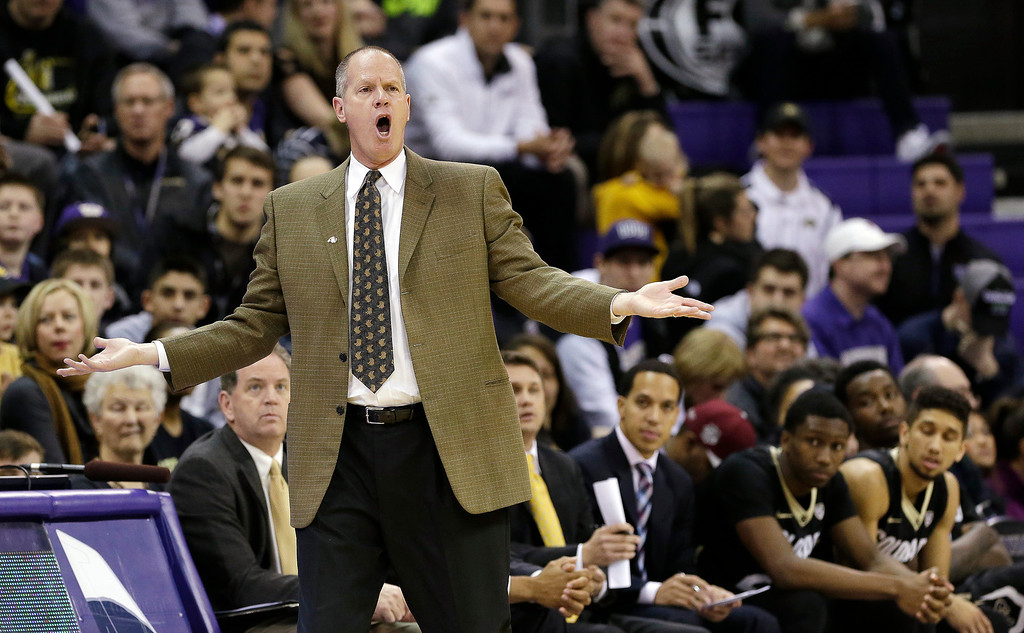 . Colorado head coach Tad Boyle yells from the sideline in the second half of an NCAA men\'s basketball game against Washington, Sunday, Jan. 12, 2014, in Seattle. Washington won 71-54. (AP Photo/Elaine Thompson)