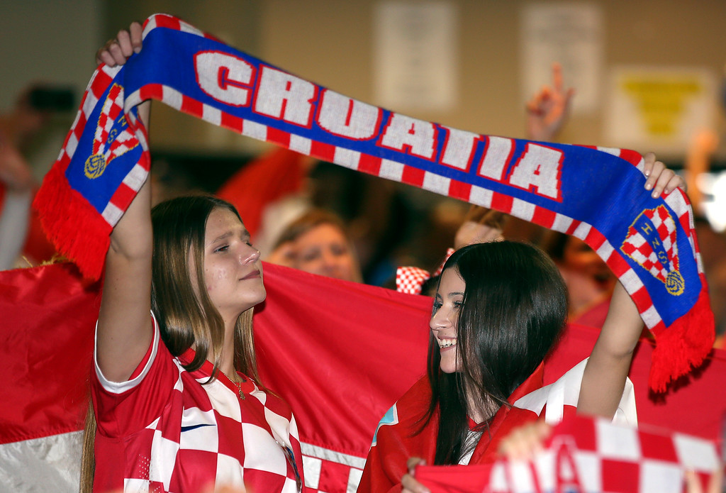 . Croatia fans at the King Tom Club in Sydney, Australia, watch the soccer World Cup final between France and Croatia, Monday, July 16, 2018. (AP Photo/Rick Rycroft)