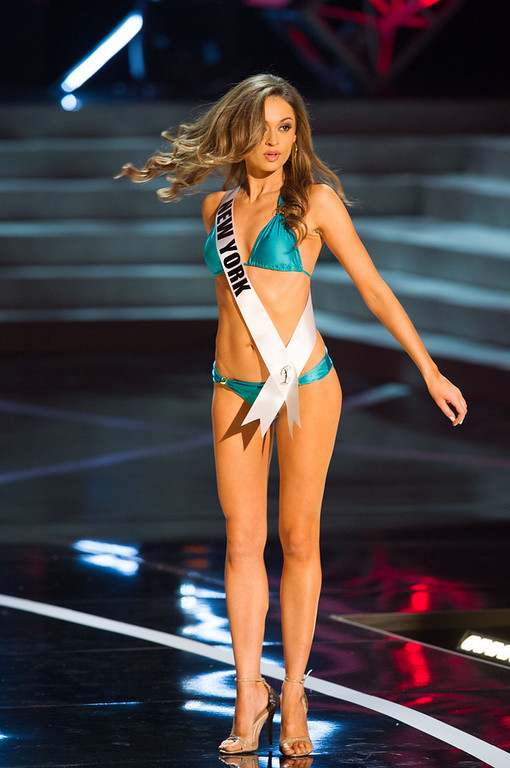 . In this photo provided by the Miss Universe Organization,  Miss New York USA 2013, Joanne Nosuchinsky,  competes in her swimsuit during the  2013 Miss USA Competition Preliminary Show in Las Vegas on Wednesday June 12, 2013.   She will compete for the title of Miss USA 2013 and the coveted Miss USA Diamond Nexus Crown on June 16, 2013.  (AP Photo/Miss Universe Organization, Darren Decker)