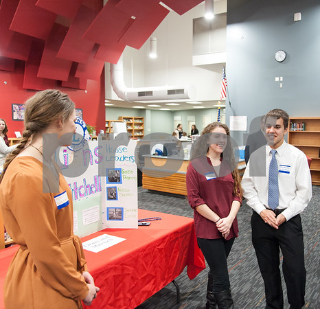 12/12/17 Wesley Bunnell | Staff The Berlin Upbeat Club held their 2017-18 Senior Expo on Tuesday evening at the high school. The expo featured Upbeat House Leaders discussing the focus of each house's activities. Natalie Coucerio, L, Jennifer Errico and Gabriel Ramsey of Lions and Mitchell House.