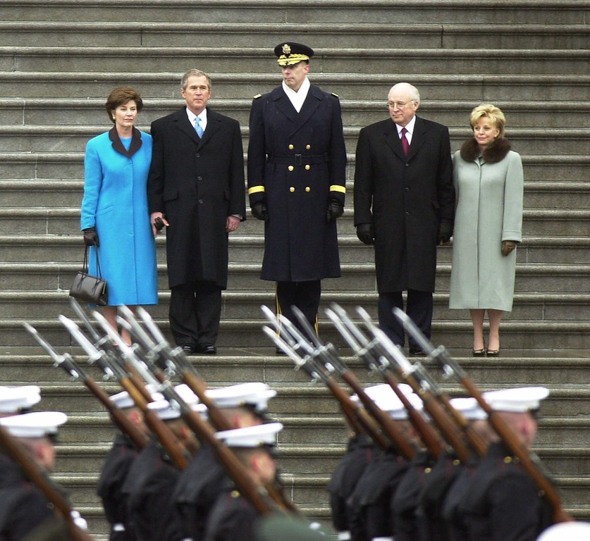 . President George W. Bush with wife Laura, left, reviews the troops from the steps of the Capitol with Vice President Dick Cheney, and his wife Lynne, right, after their inauguration in Washington, Saturday, Jan. 20, 2001. (AP Photo/Eric Gay)