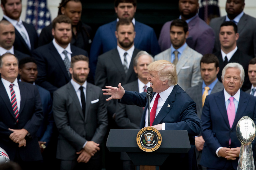 . President Donald Trump, with New England Patriots head coach Bill Belichck, left, New England Patriots owner Robert Kraft, right, and members of the New England Patriots, speaks during a ceremony on the South Lawn of the White House in Washington, Wednesday, April 19, 2017, where the president honored the Super Bowl Champion New England Patriots for their Super Bowl LI victory. (AP Photo/Andrew Harnik)