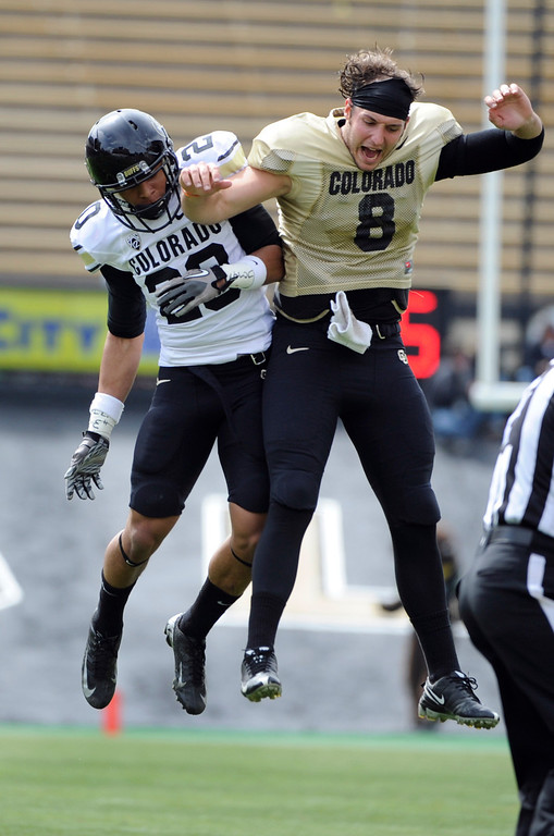 . BOULDER, CO.- APRIL13: Greg Henderson, left, celebrates a white team fumble recovery with QB Nick Hirschman. The University of Colorado football team hosts its spring football game at Folsom Field under the direction of new head coach Mike MacIntyre. (Photo By Kathryn Scott Osler/The Denver Post)