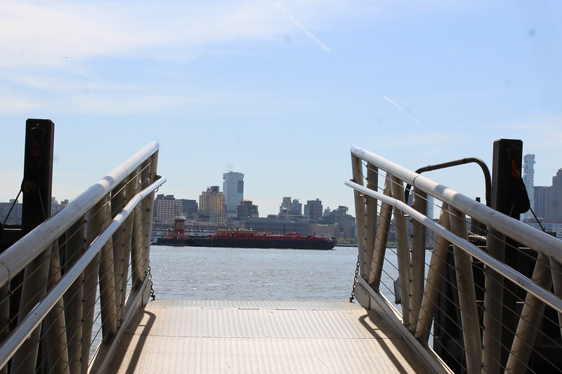 Barge and Tugboat from ramp.JPG