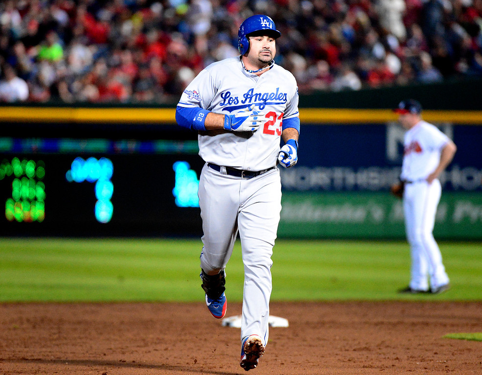 . Los Angeles Dodgers\' Adrian Gonzalez heads home after hitting a home run and bringing the score to 4-0 as they play the Atlanta Braves in the first game of the playoffs Thursday, October 3, 2013 at Turner Field in Atlanta, Georgia. (Photo by Sarah Reingewirtz/Pasadena Star- News)