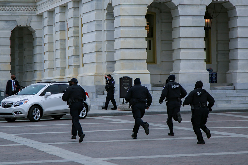 U.S. Capitol Police rush to respond as demonstrators breach the building's perimeter