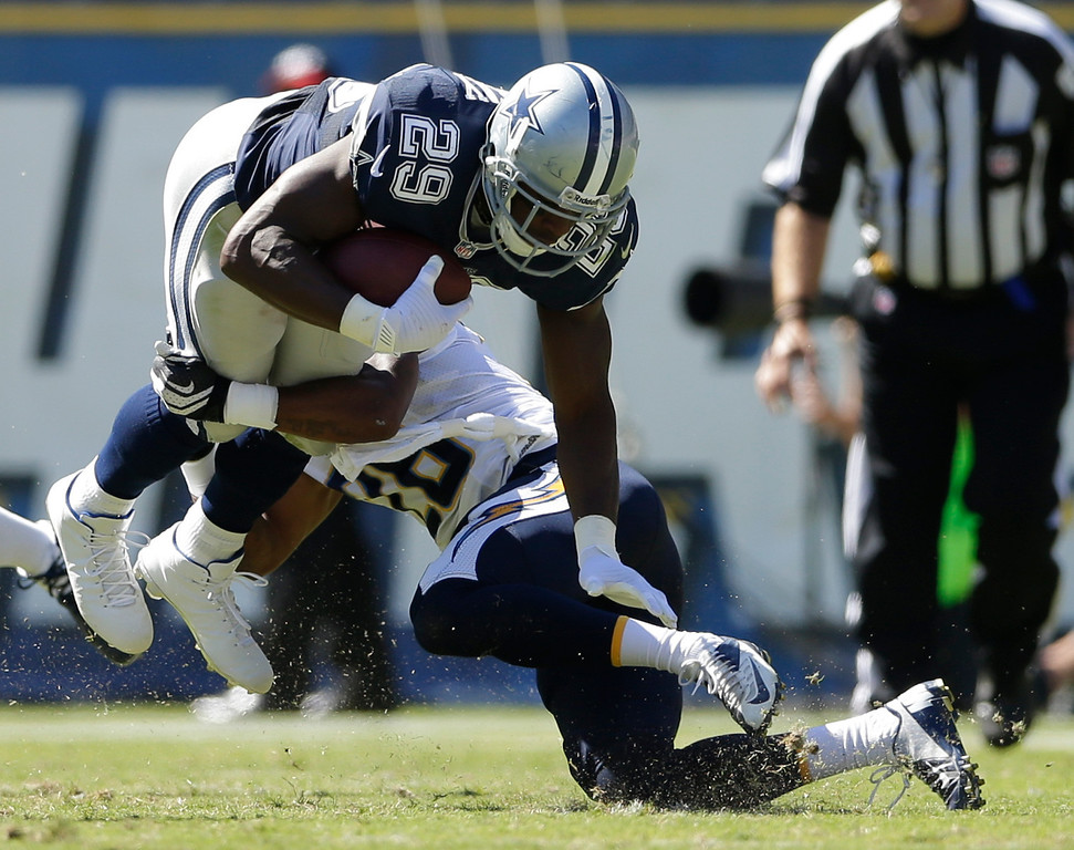 . San Diego Chargers cornerback Johnny Patrick, right, tackles Dallas Cowboys running back DeMarco Murray during the first half of an NFL football game Sunday, Sept. 29, 2013, in San Diego. Patrick was hunt on the play.  (AP Photo/Gregory Bull)