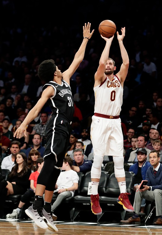 . Cleveland Cavaliers\' Kevin Love (0) shoots over Brooklyn Nets\' Jarrett Allen (31) during the first half of an NBA basketball game Wednesday, Oct. 25, 2017, in New York. (AP Photo/Frank Franklin II)