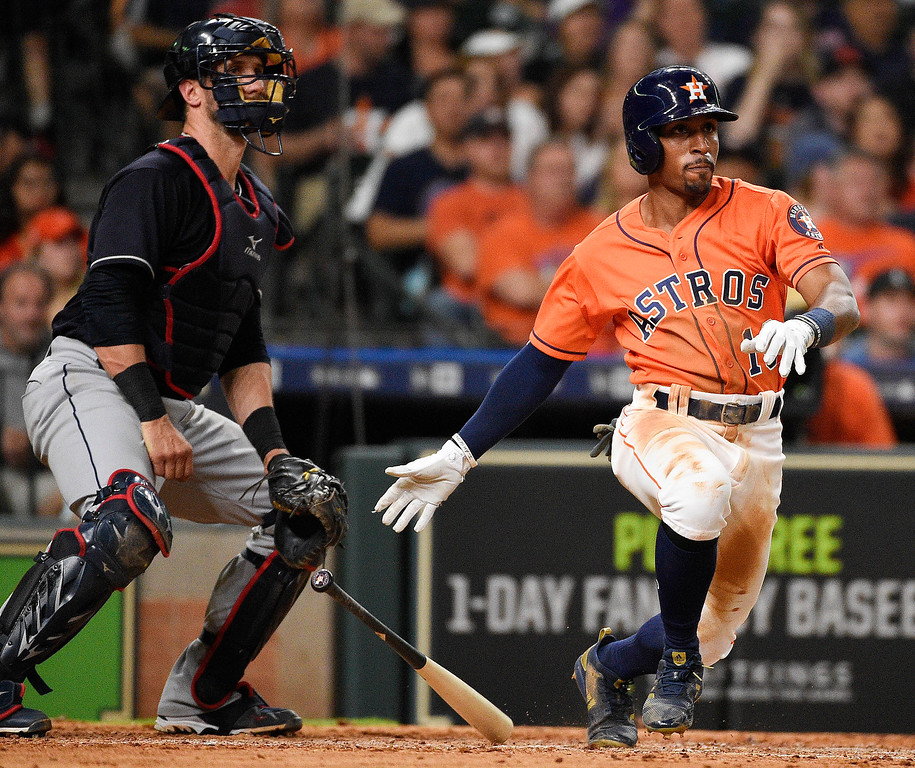 . Houston Astros\' Tony Kemp watches his two-run double in front of Cleveland Indians catcher Yan Gomes during the seventh inning of a baseball game Friday, May 18, 2018, in Houston. (AP Photo/Eric Christian Smith)