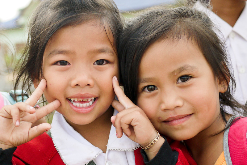Two girls ham it up for the camera in Hongsa, Laos.
