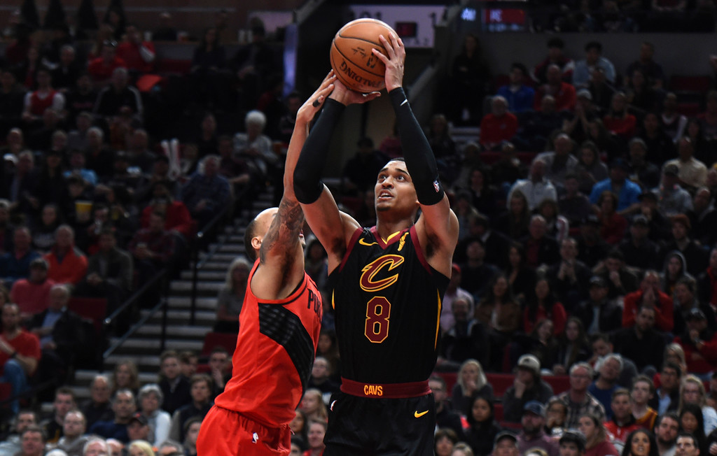 . Cleveland Cavaliers guard Jordan Clarkson, right, drives to the basket on Portland Trail Blazers guard Shabazz Napier, left, during the first half of an NBA basketball game in Portland, Ore., Thursday, March 15, 2018. (AP Photo/Steve Dykes)