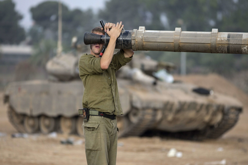 . An Israeli soldier adjusts the cannon of a Merkava tank positionned along the border between Israel and the Hamas-controlled Gaza Strip on July 29, 2014.  AFP PHOTO / JACK GUEZ/AFP/Getty Images