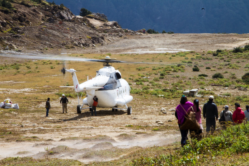 Large cargo transport helicopter sits at Syangboche Airport in Nepal's Himalayas