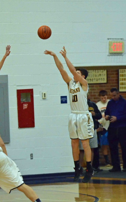 . Paul DiCicco - The News-Herald Kirtland�s Dylan Fulco shoots a 3-pointer to open the game.
