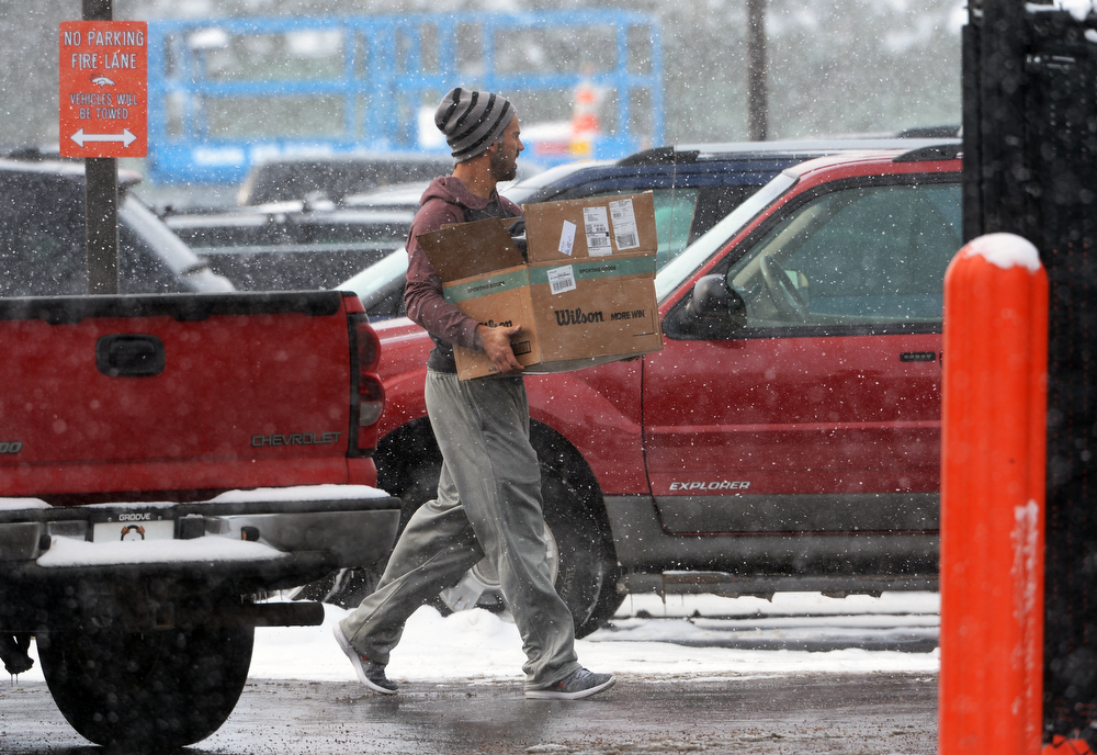 . Denver Broncos wide receiver Eric Decker carries a box of his belongings to his car as he and other players leave Dove Valley for the season  in Englewood, Co on February 4, 2014. (Photo By Helen H. Richardson/ The Denver Post)