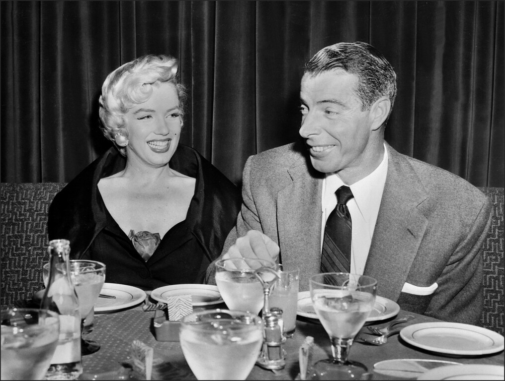 . Picture dated of the fifties showing American actress Marilyn Monroe (L) with her husband baseball legend Joe DiMaggio. (AFP/AFP/Getty Images)