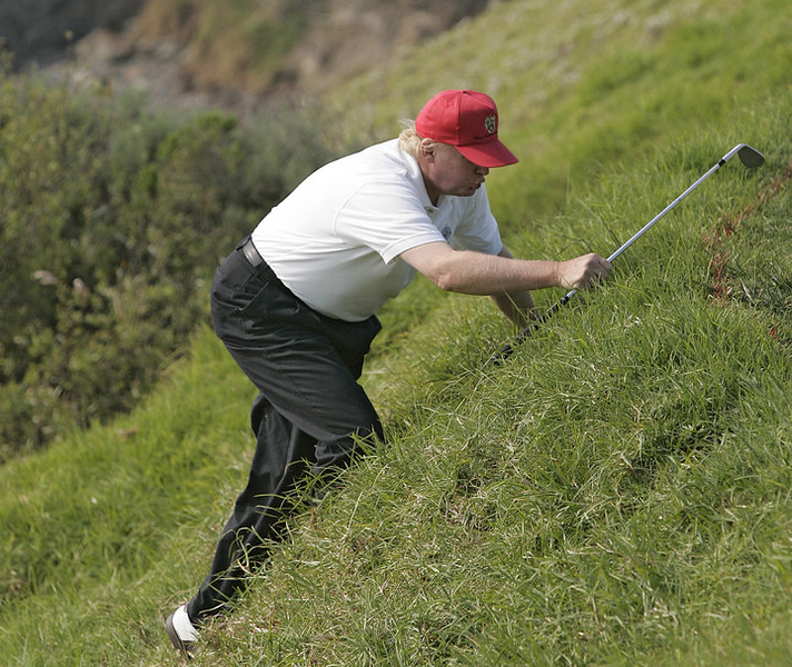 UNITED STATES - FEBRUARY 11:  Donald Trump climbs back up to the green after chipping during the third round of the AT&T Pebble Beach National Pro-Am on Pebble Beach Golf Links in Pebble Beach, California on February 11, 2006.  (Photo by Chris Condon/PGA)