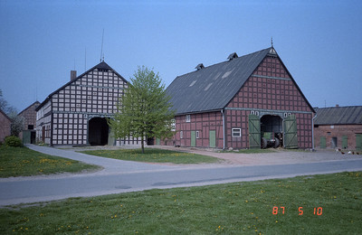 Two of the typical  barns built in this part of West Germany.  Very large and solidly built, usually of brick.  Note the German scrip right above the barn door openings, and stretching the entire width of the barn.  Also more script further up the front of the barn.