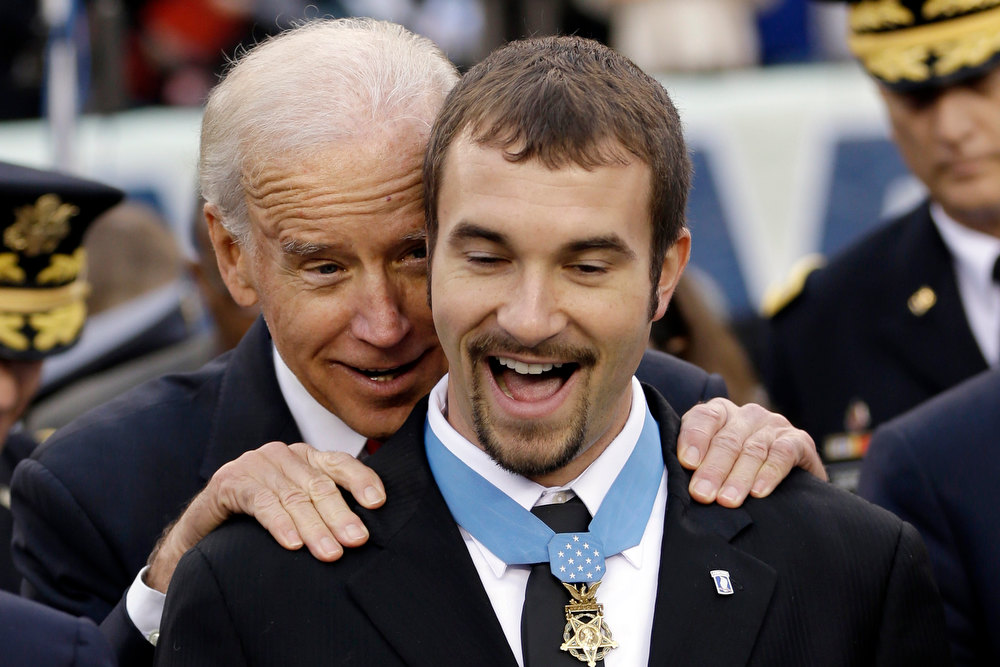 . Vice President Joe Biden meets with Salvatore Giunta a recipient of the Medal of Honor before an NCAA college football  game between the Army and the Navy, Saturday, Dec. 8, 2012, in Philadelphia. (AP Photo/Matt Rourke)