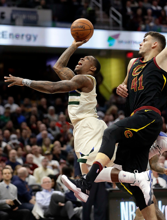 . Cleveland Cavaliers\' Ante Zizic, right, from Croatia, fouls Milwaukee Bucks\' Eric Bledsoe in the second half of an NBA basketball game, Monday, March 19, 2018, in Cleveland. (AP Photo/Tony Dejak)