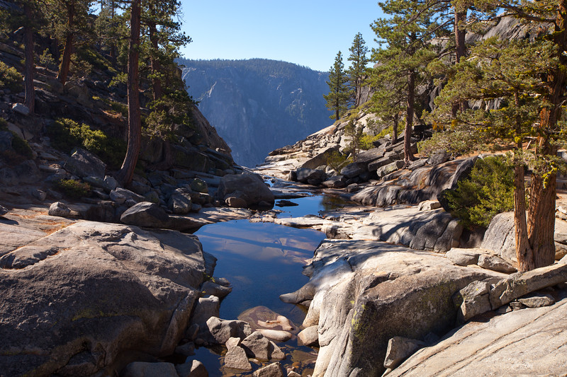 YOSEMITE, CA - Three day backpacking trip with the Southern Yosemite Mountain Guides (SYMG) along the north rim of Yosemite Valley with views of Yosemite Falls and Half Dome.