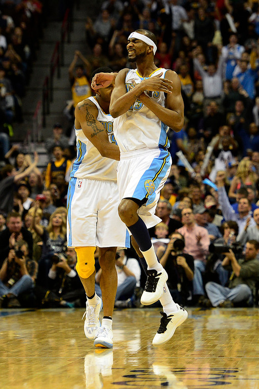. Denver Nuggets small forward Corey Brewer (13) celebrates a three pointer against the Los Angeles Lakers during the second half of the Nuggets\' 126-114 win at the Pepsi Center on Wednesday, December 26, 2012. AAron Ontiveroz, The Denver Post