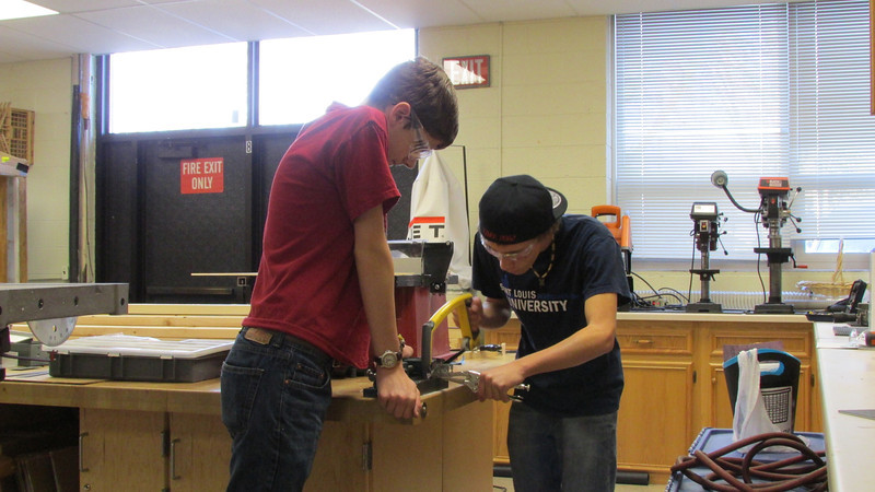 "Matthew and ""Sushi"" working on sawing a small part."