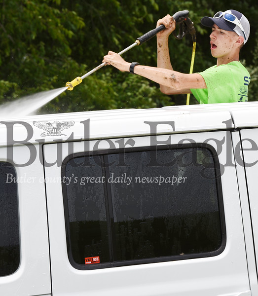 Harold Aughton/Butler Eagle: Hunter Rock of Portersville joined his Boy Scout Troop 806 to raise funds washing jeeps at the 2019 Bantham Jeep Festival.