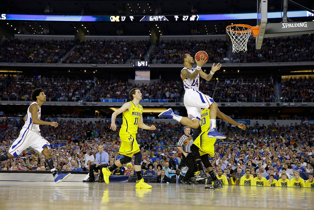 . Kansas\' Travis Releford (24) shoots against Michigan during the first half of a regional semifinal game in the NCAA college basketball tournament, Friday, March 29, 2013, in Arlington, Texas. (AP Photo/David J. Phillip)