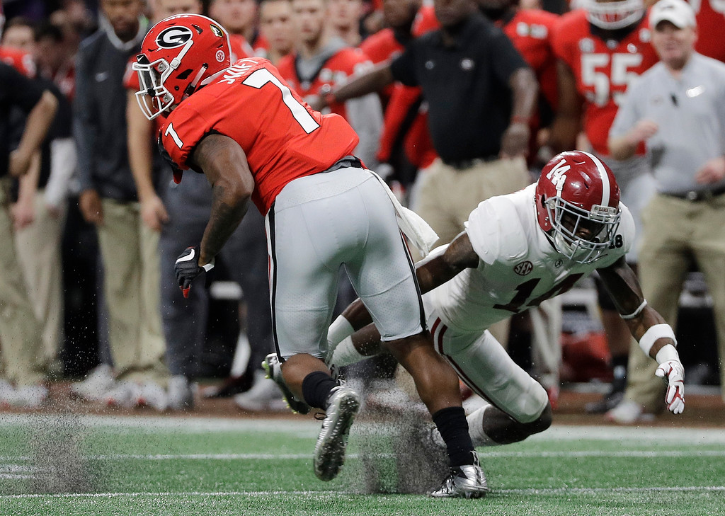 . Georgia running back D\'Andre Swift gets past Alabama\'s Deionte Thompson for a first down catch during the first half of the NCAA college football playoff championship game Monday, Jan. 8, 2018, in Atlanta. (AP Photo/David J. Phillip)