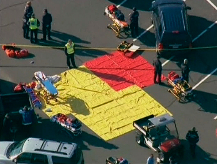 . Emergency personnel set up in the parking lot after a shooting at Sandy Hook Elementary School in Newtown, Connecticut, December 14, 2012.  REUTERS/WNBC/Handout