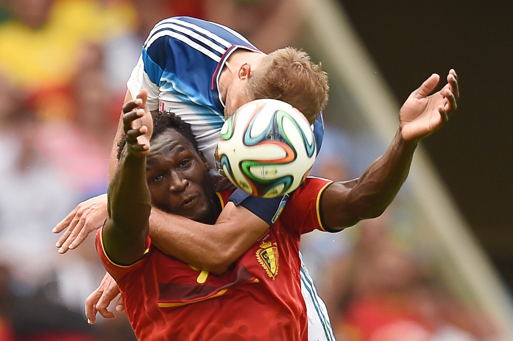 . Belgium\'s forward Romelu Lukaku (L) is tackled by Russia\'s defender Vasily Berezutsky  during the Group H football match between Belgium and Russia at The Maracana Stadium in Rio de Janeiro on June 22, 2014, during the 2014 FIFA World Cup.   KIRILL KUDRYAVTSEV/AFP/Getty Images