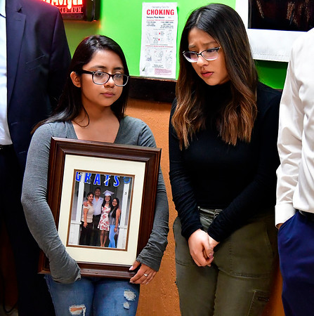 12/21/2018 Mike Orazzi | Staff Sisters Bitzania Jalinne Iriarte during a gathering at Plainville's El Paso Mexican Restaurant on East Main Street in support of their father Isaias Iriarte who is currently under a deportation order and being held at the Bristol County Sheriff's Department in Massachusetts.