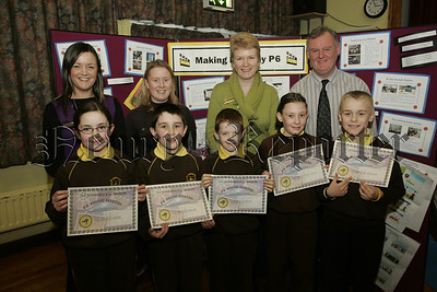 Meigh Movie Makers. Pictured are pupils primary 6 pupils from St Joseph's P.S. Meigh who have produced films on the theme of Bullying as part of safety week which covered personal safety and bullying. Also pictured are teacher Mrs Joanne Brenan, Vanessa McGee, Vine Haugh and school Principal Mr Brian McKinley. 07W4N5
