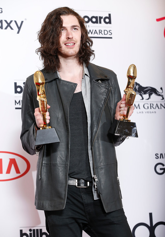 ". Hozier poses in the press room with the awards for top rock artist and top rock song for ""Take Me to Church\"" at the Billboard Music Awards at the MGM Grand Garden Arena on Sunday, May 17, 2015, in Las Vegas. (Photo by Eric Jamison/Invision/AP)"