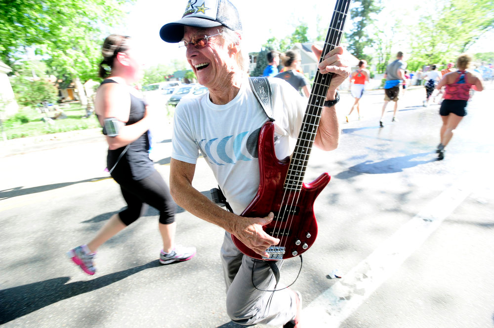 . Guitarist Jackson Mammele entertains the runners during the 2013 Bolder Boulder in Boulder Colorado.  Photo by Paul Aiken / The Boulder Daily Camera / May 27, 2013