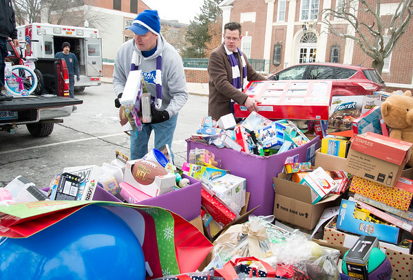 12/13/19 Wesley Bunnell | StaffrrToys, warm clothes, non perishable food items were collected on Friday from 6 a.m. until noon outside of CCSU's Davidson Hall in conjunction with CCSU and The Anna Grace Project's Love Wins. Steve VanVoorhis, L, and Robert Jost from CCSU's Facilities Department help load toys onto fire department trucks.