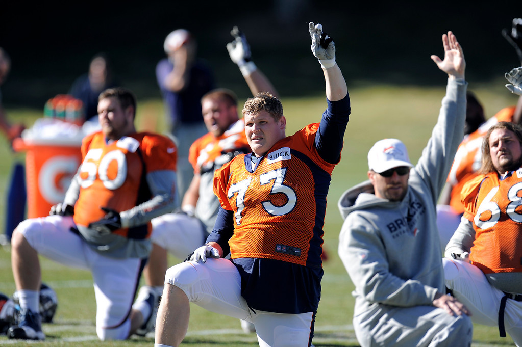 . Denver Broncos guard Chris Kuper (73) stretches before practice November 13, 2013 at Dove Valley (Photo by John Leyba/The Denver Post)