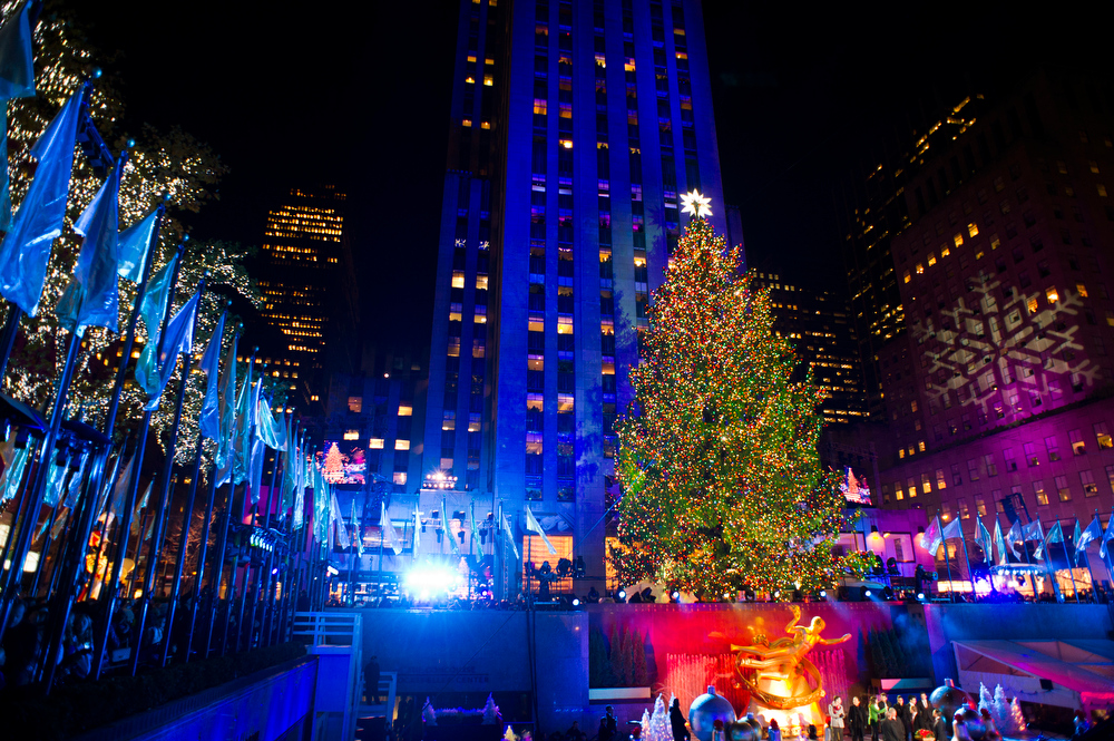Description of . The 80-foot-tall Rockefeller Center Christmas tree is lit using 45,000 energy efficient LED lights during the 80th annual lighting ceremony on Wednesday, Nov. 28, 2012 in New York. (Photo by Charles Sykes/Invision/AP)