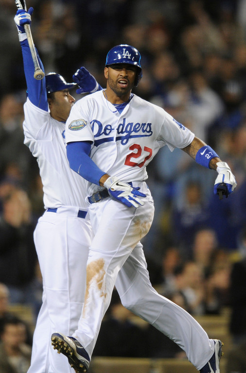 . Matt Kemp is congratulated by Jerry Hairston after Kemp was driven in by Andre Ethier in the 6th inning. The Dodgers played host to the Pittsburgh Pirates in a game played at Dodger Stadium in Los Angeles, CA 4/11/2012(John McCoy/Staff Photographer)