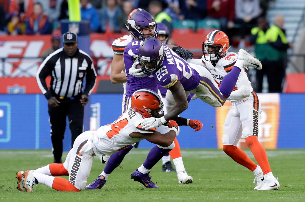 . Minnesota Vikings running back Latavius Murray (25) is tackled by Cleveland Browns defensive back Ibraheim Campbell, left, during the first half of an NFL football game at Twickenham Stadium in London, Sunday Oct. 29, 2017. (AP Photo/Matt Dunham)